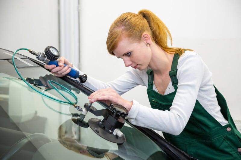 girl repairing windscreen